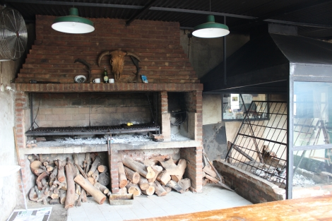 Parrilla on the left and classic asado on the right where they hang meats over an open fire