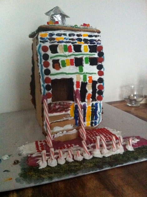 "We missed 2009. This is 2010 model made in our Brownstone at 129 Hicks Street. We tried to make a brownstone, but some complications with the caramel and difficulty making a pretty structure lead us to this Gingerbread ""Crackhouse"" as we all called it..."