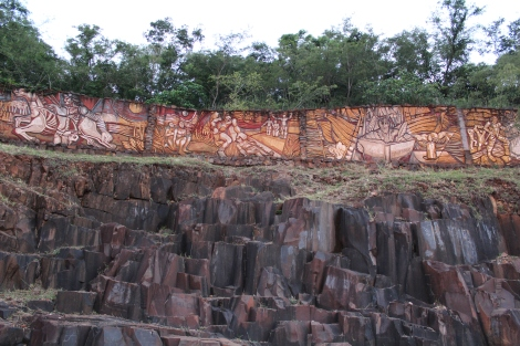 "This was so cool. From far away I thought the ""mural"" was graffiti, but getting closer you can see that it is actually a wood carving that spans the side of the hill. That with the formation of the rocks below makes the walk along the river very interesting."